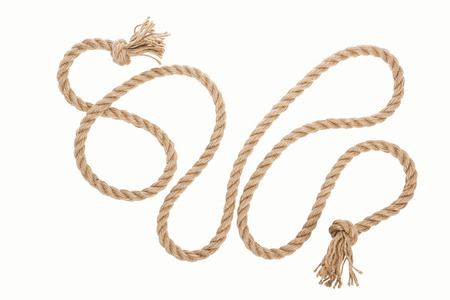 long jute rope with curls and knots isolated on white