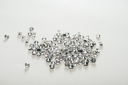 transparent pure small diamonds scattered on white background 写真素材