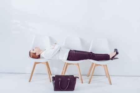 attractive employee lying on chairs while waiting job interview