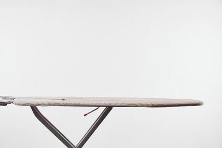 Ironing board with dark steel legs isolated on white 免版税图像
