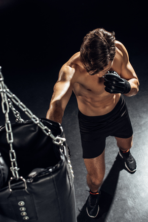 High angle view of boxer training with punching bag