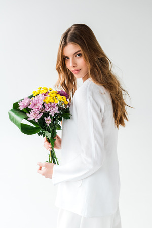 Attractive girl holding bouquet of wildflowers on white background Reklamní fotografie