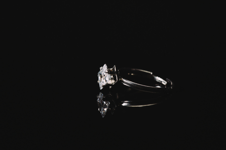 Engagement ring with pure diamond isolated on black background Stock Photo