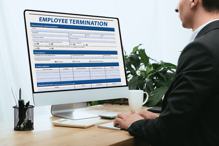 Cropped view of man filling in Employee Termination Form Contract Concept