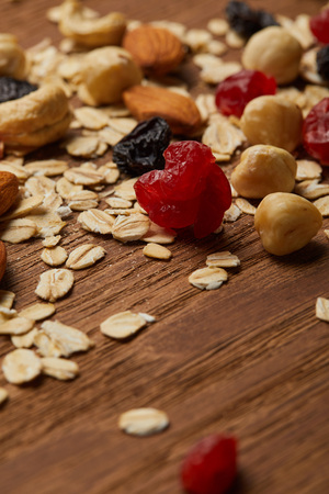 Close up of oat flakes with dried berries and hazelnuts on wooden table 写真素材
