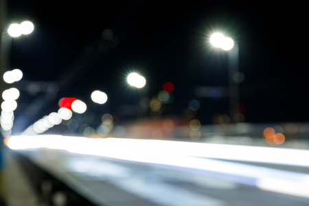 long exposure of bright city lights on road at night
