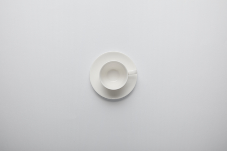 Top view of empty cup and saucer on grey 写真素材