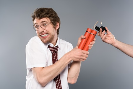 frightened man holding dynamite while another holding lighter with fire Imagens