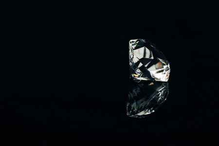 transparent pure diamond isolated on black with reflection Stock Photo