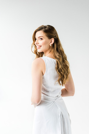 attractive happy girl in dress smiling on white