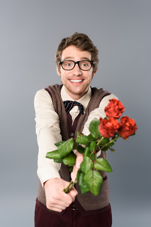 smiling man in glasses gifting bouquet of roses