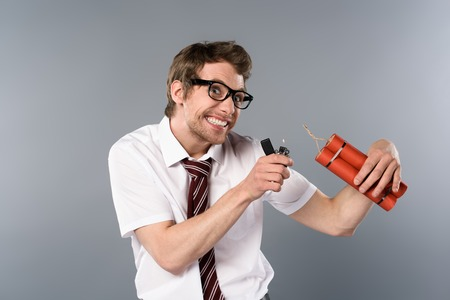 cunning businessman holding lighter and dynamite on grey background Stok Fotoğraf