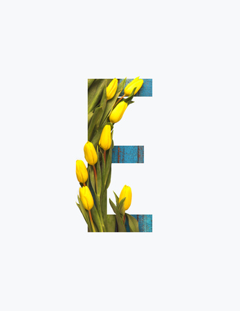 Cyrillic letter with yellow tulips isolated on white