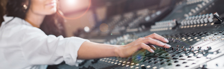 panoramic shot of sound producer working at mixing console Stock fotó