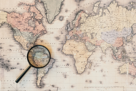 Top view of magnifying glass on world map Stock Photo