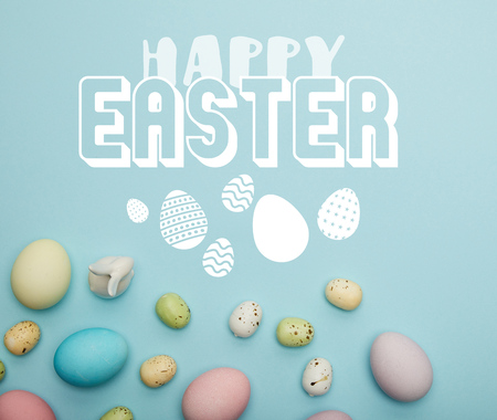 top view of painted multicolored eggs scattered and decorative white bunny on blue background with happy Easter lettering