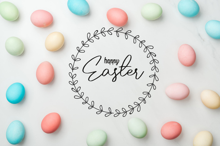 top view of multicolored chicken painted eggs on grey background with happy Easter lettering in circle frame