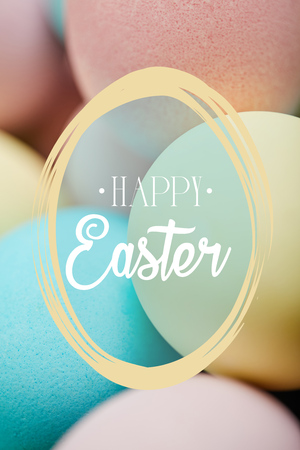 close up of painted chicken eggs for Easter with happy Easter lettering Standard-Bild - 121451103