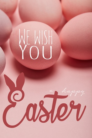 pink painted chicken eggs with we wish you happy Easter lettering