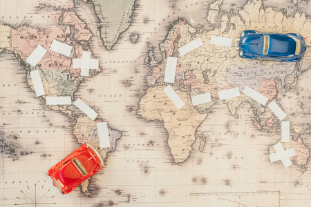 Top view of red and blue toy cars on world map Stock fotó - 121460780