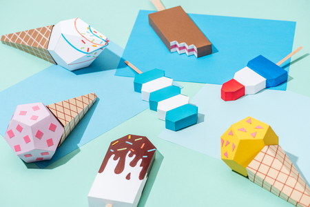 handmade origami ice cream on blue and turquoise paper