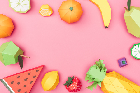 top view of handmade colorful origami fruits on pink with copy space Stock Photo