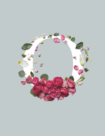White letter O with pink eustoma flowers and green leaves isolated on grey background