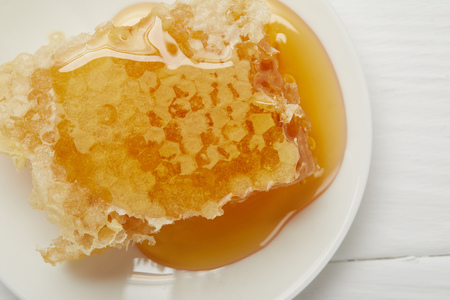 top view of plate with delicious Honeycomb on white table Banco de Imagens