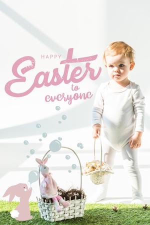 Cute baby standing with wicker basket on green grass near golden quail eggs, happy Easter to everyone lettering and rabbit blowing soap bubbles illustration