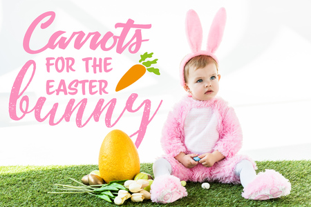 cute baby in bunny costume sitting near colorful chicken eggs, tulips and yellow ostrich egg with carrots for the Easter bunny illustration Zdjęcie Seryjne