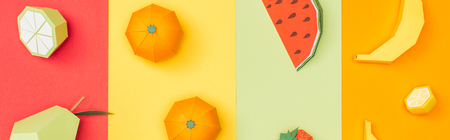 Panoramic shot of various origami fruits on colorful paper stripes background