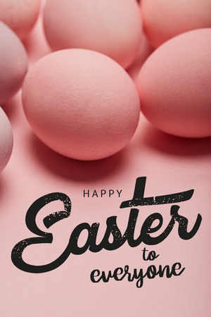 Pink painted chicken eggs with black happy Easter to everyone lettering