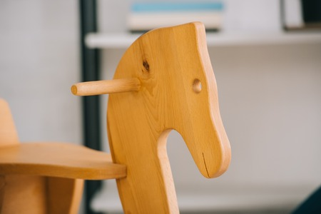 Selective focus of wooden rocking horse in living room Stock Photo