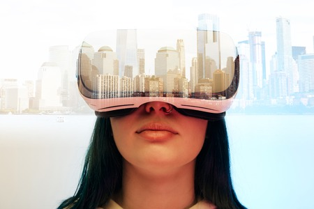 Double exposure of brunette girl wearing virtual reality headset and modern city with skyscrapers Stok Fotoğraf - 122291794