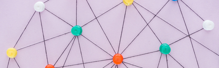 Panoramic shot of colorful push pins connected with strings isolated on pink, network concept