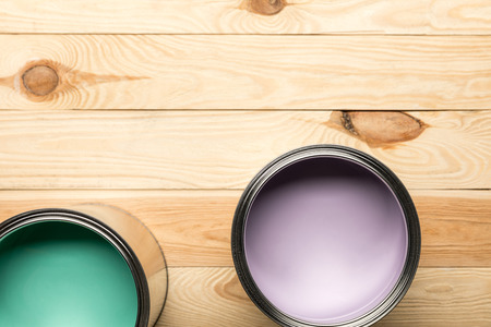 Top view of tins with paints on wooden surface Stock Photo