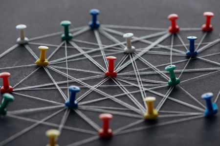 Colorful pins connected with strings isolated on grey, network concept Stockfoto