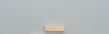 panoramic shot of wooden block isolated on grey with copy space