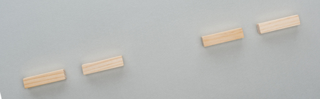 Panoramic shot of wooden blocks isolated on grey background