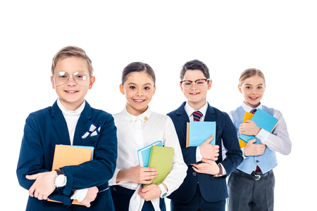 happy schoolchildren pretending to be business people with books Isolated On White Stock Photo