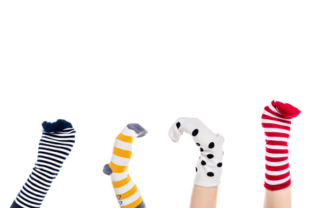 cropped view of people with colorful sock puppets on hands Isolated On White with copy space Banque d'images - 122766489