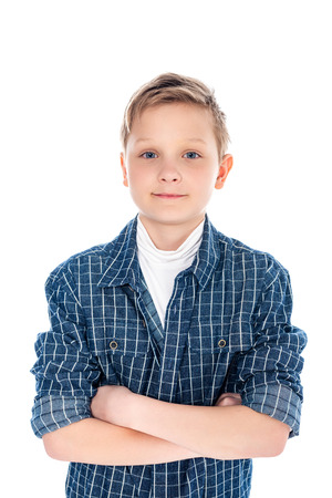 adorable boy in casual clothes with crossed arms isolated on white