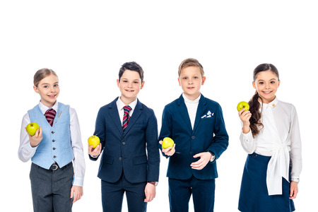 smiling schoolchildren pretending to be businesspeople with apples Isolated On White 版權商用圖片