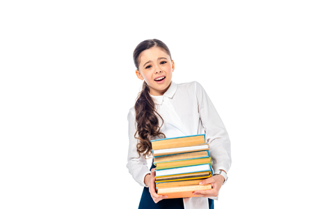 schoolgirl in formal wear looking at camera and holding books Isolated On White with copy space Imagens