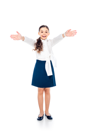 happy schoolgirl in formal wear with outstretched hands on white