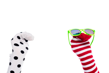cropped view of person with colorful sock puppets and sunglasses on hands Isolated On White Stockfoto