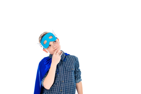 pensive boy in superhero costume touching chin Isolated On White with copy space Stockfoto - 122767815