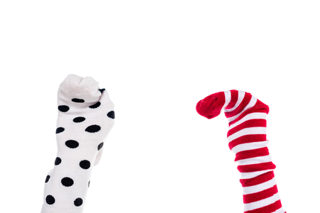 cropped view of person with colorful sock puppets on hands Isolated On White