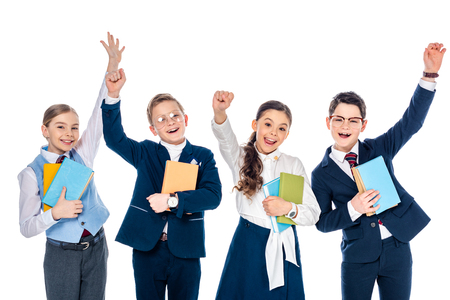 happy schoolchildren with outstretched hands holding books Isolated On White