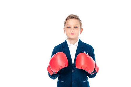 schoolboy in boxing gloves looking at camera Isolated On White with copy space Stok Fotoğraf